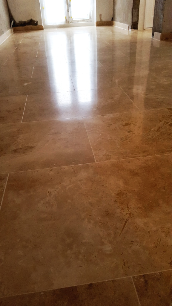 Uneven Travertine Floor After Levelling and Polishing in Swansea
