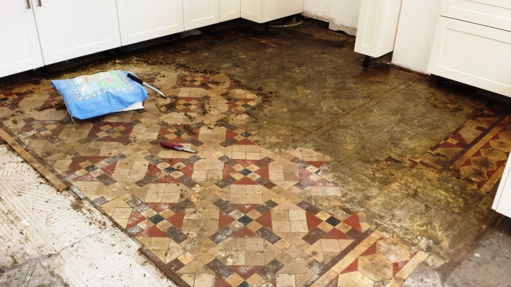 how to clean silicone off floor tiles