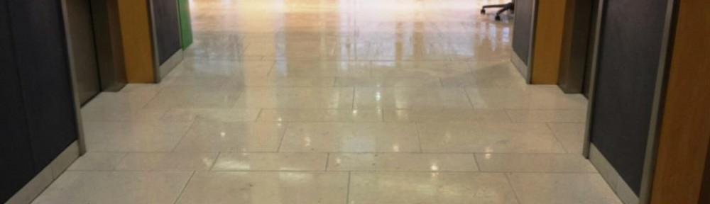 Polished Limestone Reception Floor Cleaned in Central Cardiff