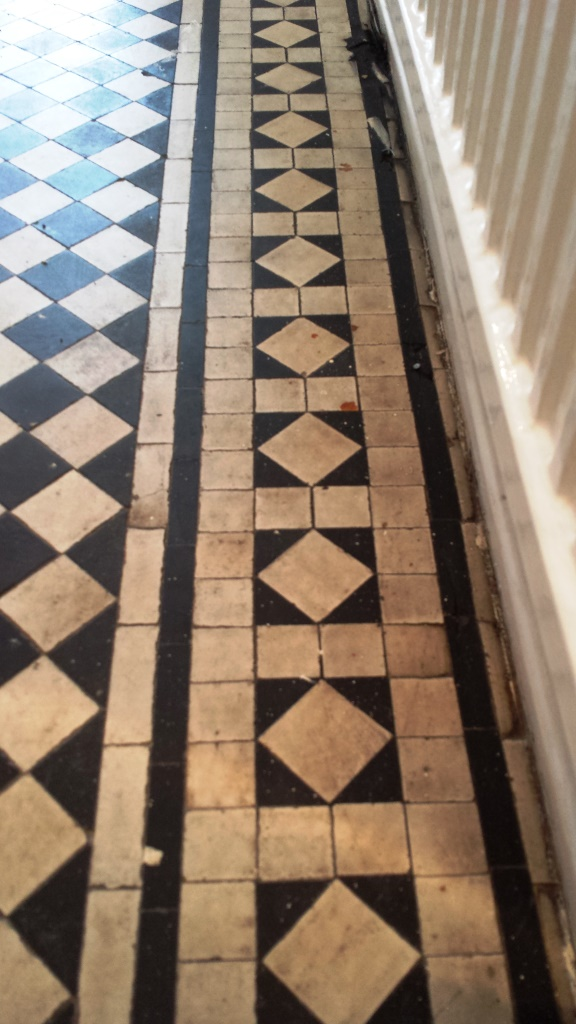 Black and white chequer Victorian Tiles Cardiff Before