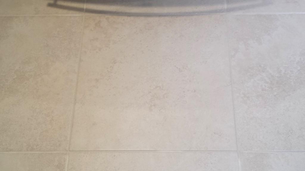 how to fix cracked bathroom floor tiles