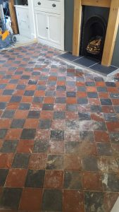 Quarry Tiled Sitting Room Floor before restoration in Splott