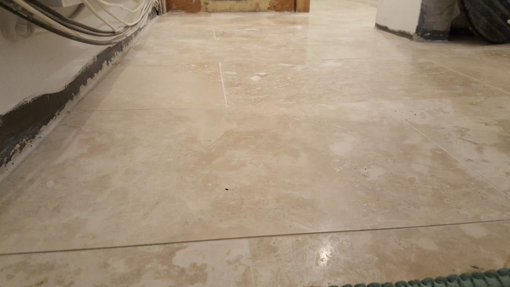 Uneven Travertine Floor Before Levelling and Polishing in Swansea