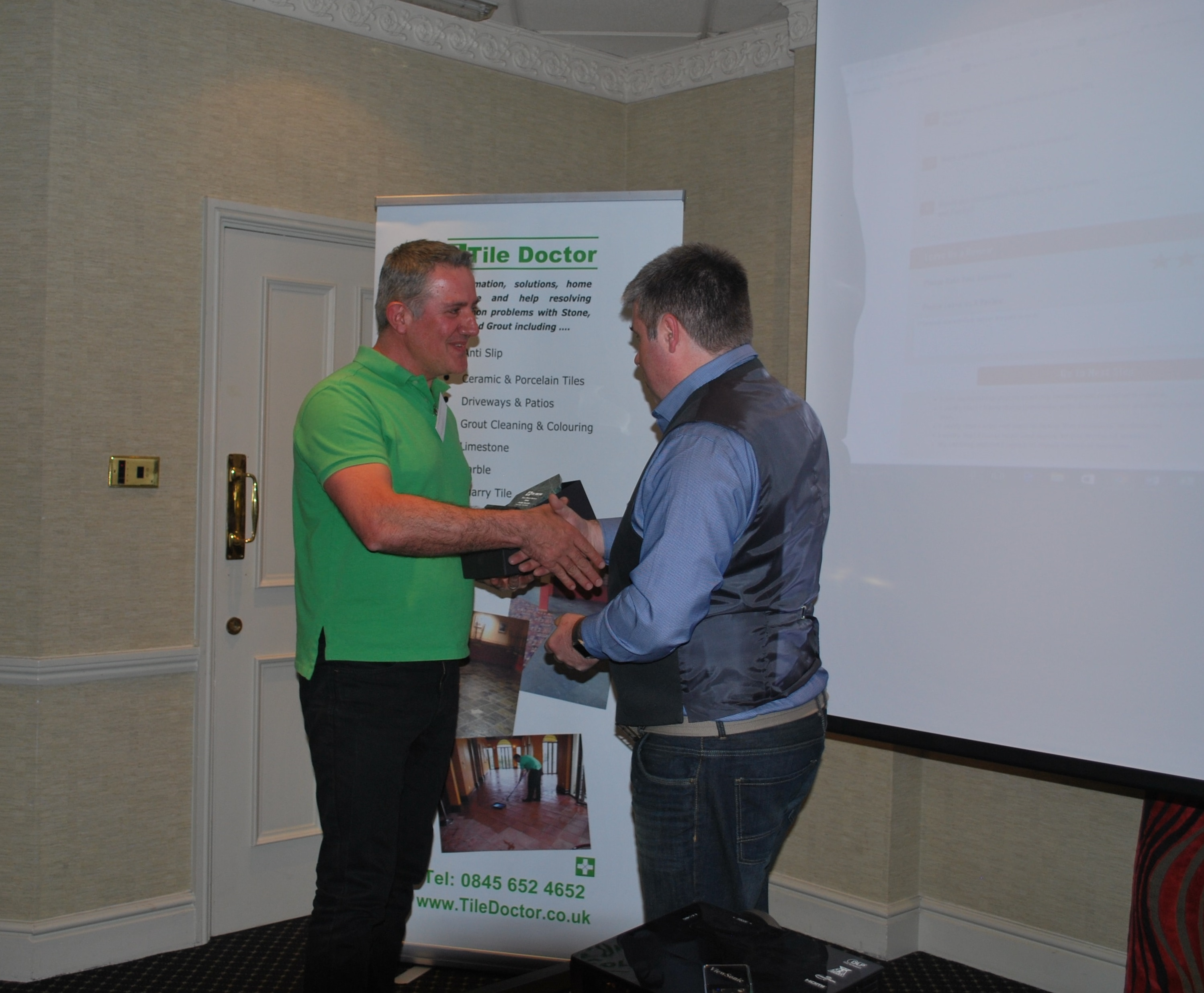 Julian Iacono being awarded the Best Restoration Award by Tile Doctor Director Russell Taylor